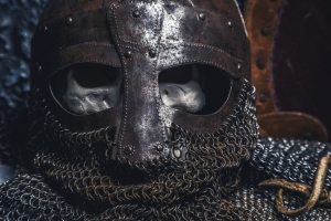 Picture man's skull in the helmet on chain armour